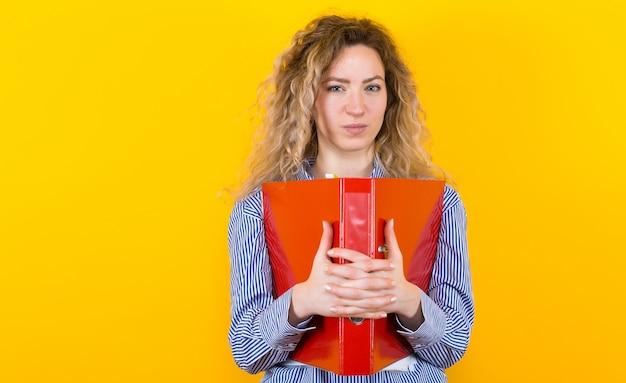 Woman in shirt with big folder