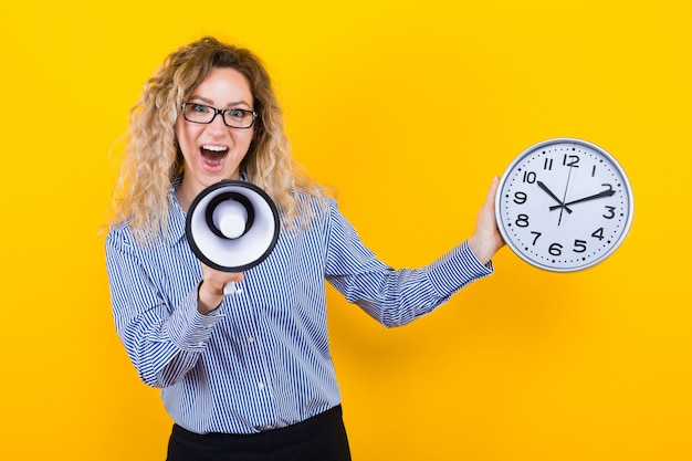 Woman in shirt with clocks and loudspeaker