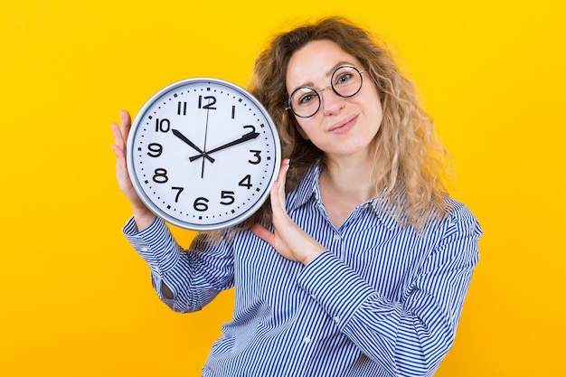 Woman in shirt with clocks
