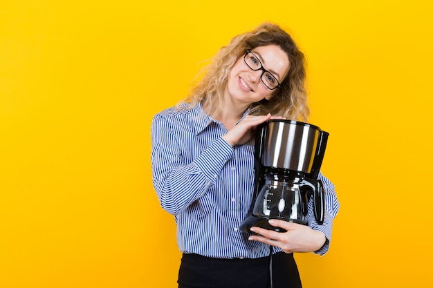 Woman in shirt with coffee machine