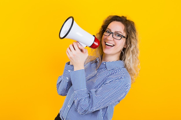 Woman in shirt with loudspeaker