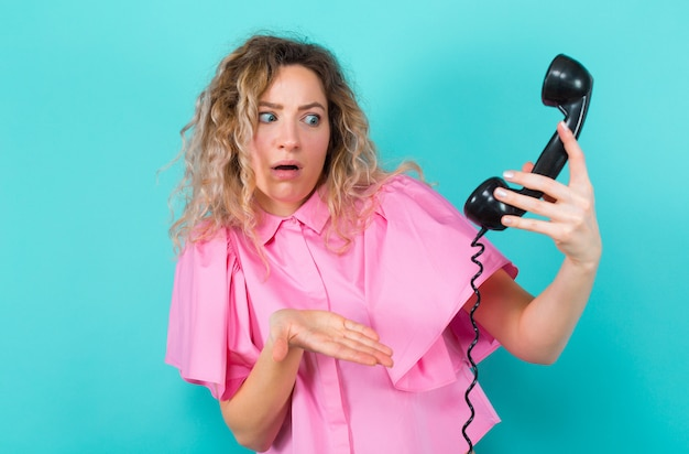 Woman in shirt with telephone