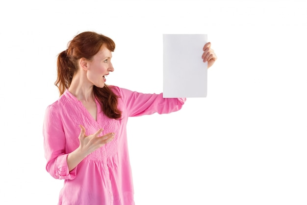 Woman shocked looking at paper