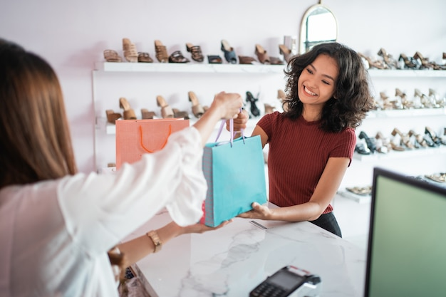 Woman shopping at boutique store in the mal
