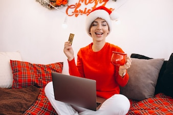 Woman shopping online on christmas