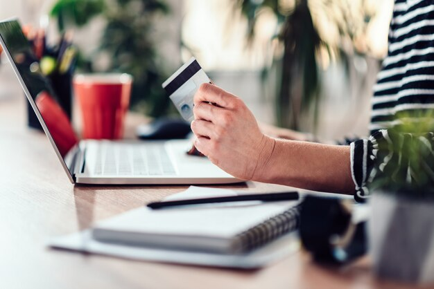 Woman shopping online and using credit card