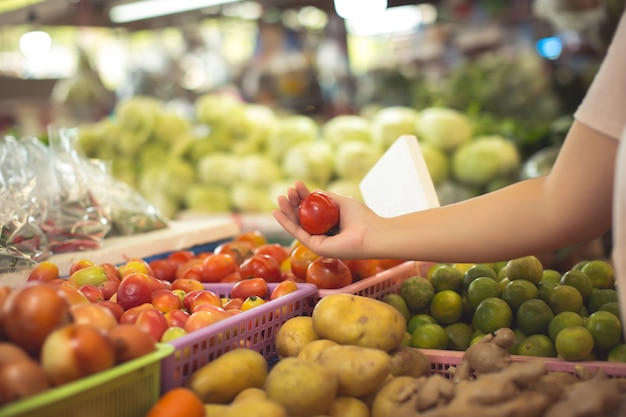 Woman shopping organic vegetables and fruits