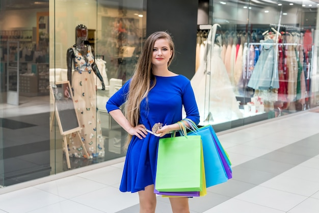 Woman on shopping thinking about next purchase