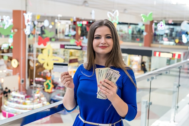 Woman on shopping with dollars and credit card