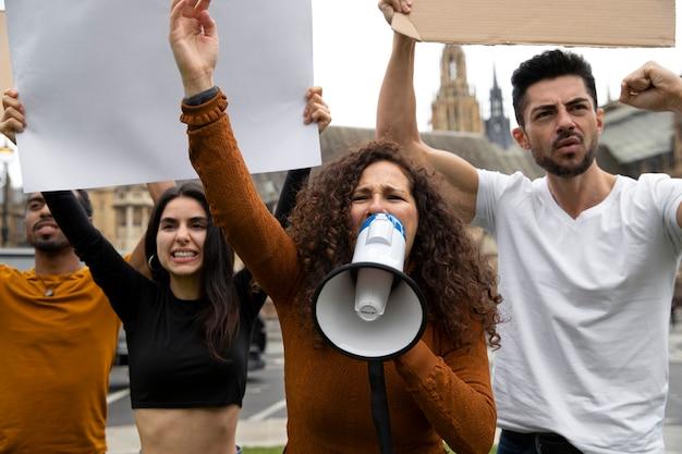 Woman shouting into a megaphone close up