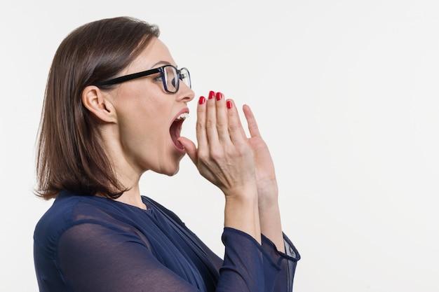 Woman shouting, screaming portrait in profile