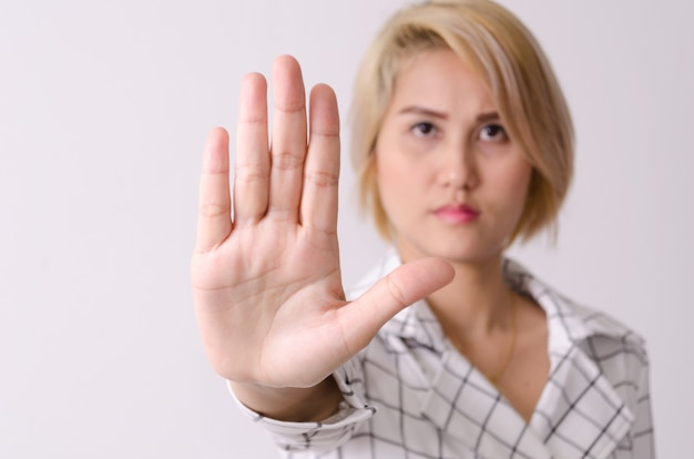 Woman show hand to stop