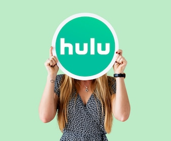 Woman showing a Hulu sign