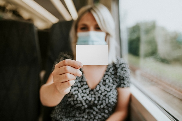Woman showing a blank card