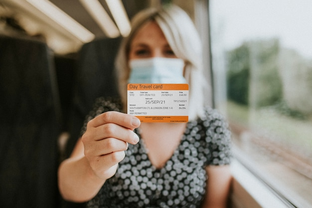 Woman showing a daily pass train ticket