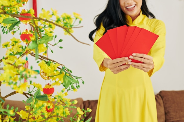 Woman showing envelopes with gifts