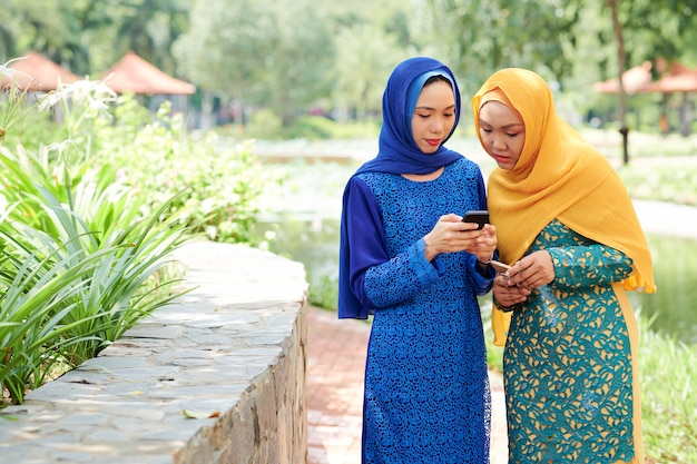 Woman showing mobile app to friend