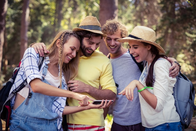 Woman showing mobile phone to friends