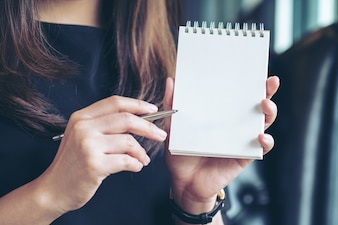 Woman showing notebook