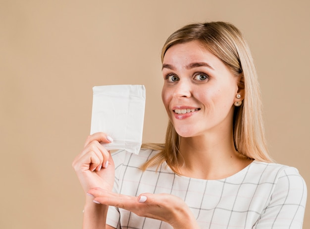 Woman showing a pad medium shot