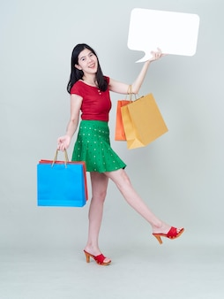 Woman showing placard empty and shopping bags.