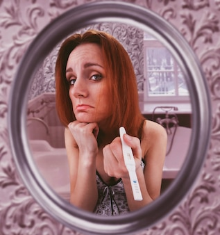 Woman showing pregnancy test
