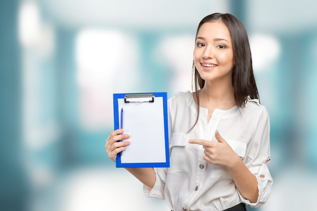Woman showing and presenting copy space