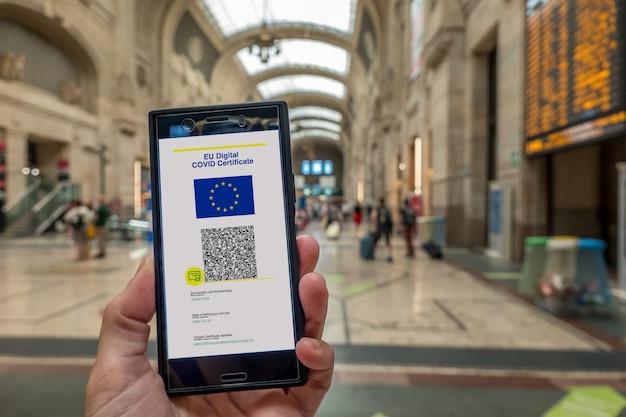 Woman showing on smartphone eu digital covid certificate