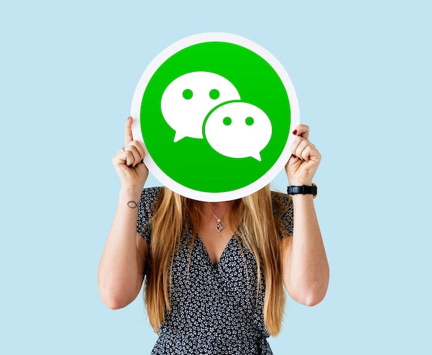 Woman showing a wechat icon