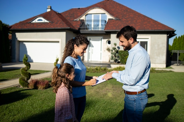 Woman signing the contract and buying new house.