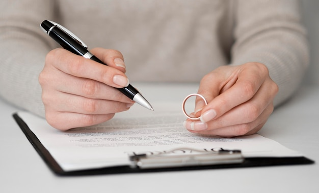 Woman signing divorce contract