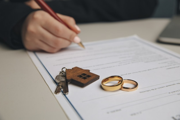 Woman signing marriage contract