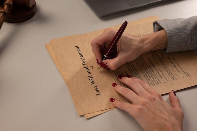 Woman signing papers at the office