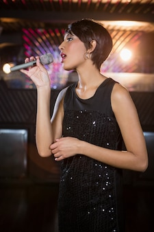 Woman singing in bar