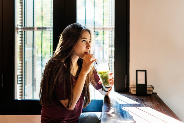 Woman sipping green tea