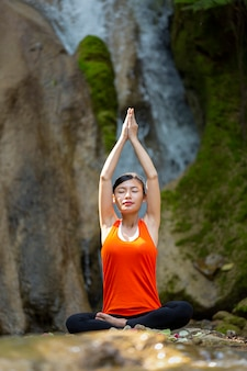 Woman sits in lotus position zen gesturing. concept of healthy lifestyle and relaxation.