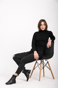 Woman sitting in a chair isolated