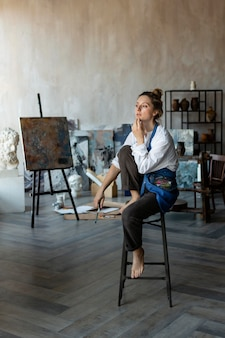 Woman sitting on chair and thinking