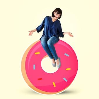 Woman sitting on a doughnut