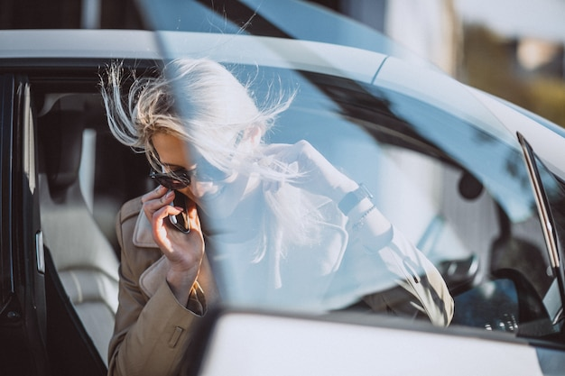 Woman sitting in electo car