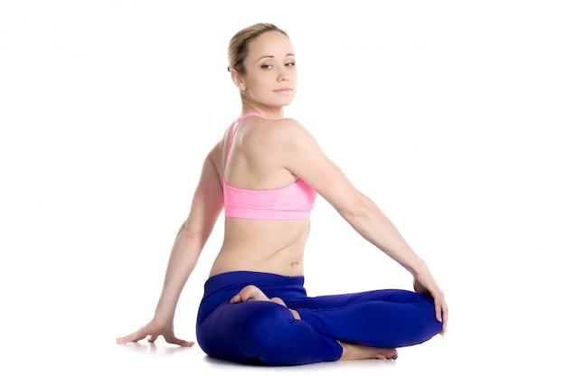 Woman sitting on the floor doing flexibility exercises
