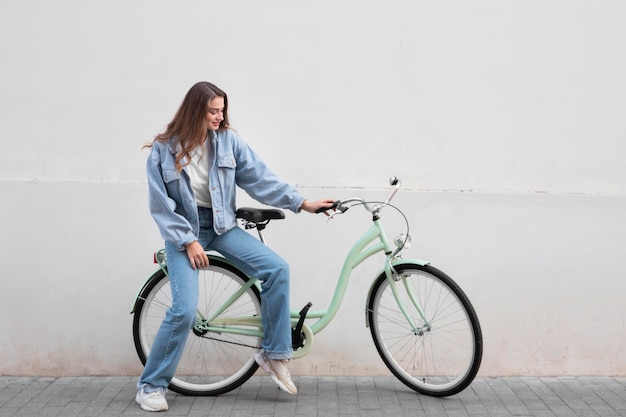 Woman sitting on her bike outdoors