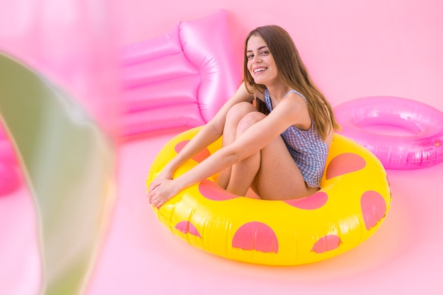 Woman sitting in inflatable ring