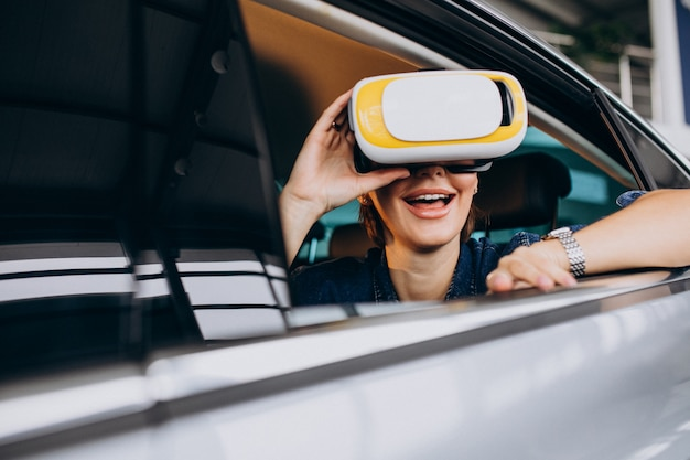 Woman sitting inside a car wearing vr glasses