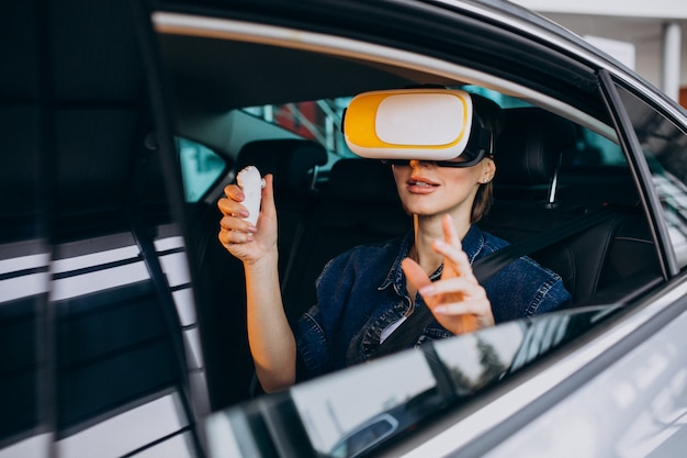 Woman sitting inside a car wearing vr glasses
