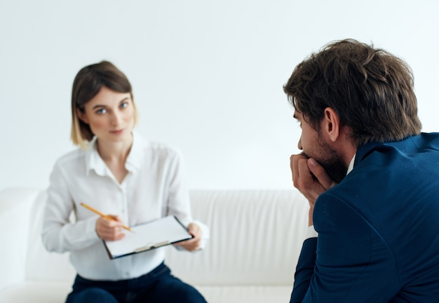 Woman sitting at the reception at the psychologist problems stress