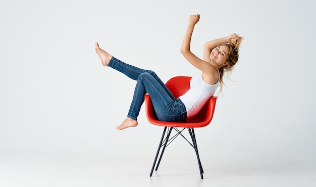 Woman sitting on red chair movement posing models