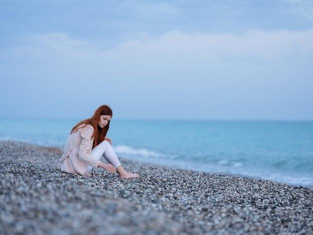 Woman sitting on the shore beach ocean landscape fresh air