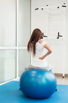 Woman sitting on therapy ball