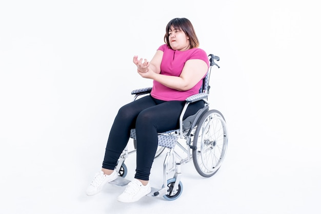 Woman sitting on a wheelchair
